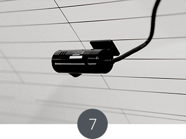 Attach the rear camera on the rear window following the same method as the front camera.