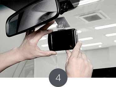 Place the product on the front window behind the room mirror horizontally with the car.